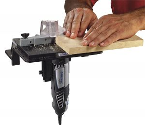 A man using a router table saw for a woodworking project