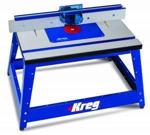 A bench top router table in bright blue